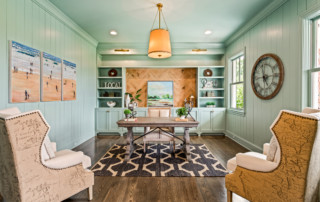 Study with custom map chairs and gorgeous seafoam shelving